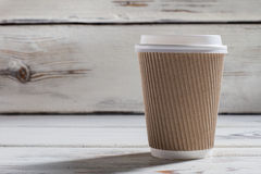 Ripple paper cup with lid. Royalty Free Stock Images