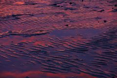 Ripple, pattern of sand on the bach. Royalty Free Stock Photo