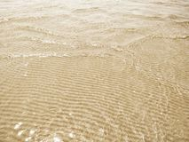 Ripple sand and sea water. Ripple sand and clear sea water stock images