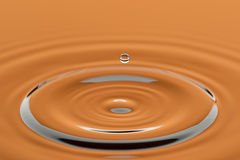 Ripple from a water drop. A water drop causes a ripple in this abstract image royalty free stock image