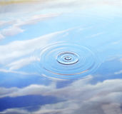 Ripple. In water with partly cloudy sky reflecting in it Stock Photography