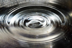 Ripple of water in sink Stock Photos