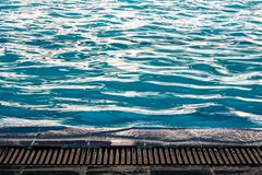 The ripple on the water surface in the pool. The ripple on the water surface in the swimming pool royalty free stock photo