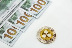 Ripple and 100 dollars. Ripple xrp and 100 dollars bills on a white background Stock Photography