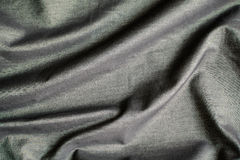 Rippled black silk fabric background Stock Image