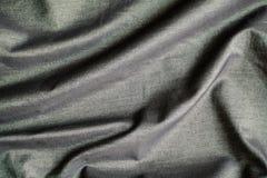 Rippled black silk fabric background Stock Image