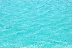 Rippled blue water in swimming pool Stock Photo