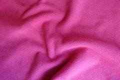 Rippled ruby red polar fleece fabric. Rippled bright ruby red polar fleece fabric Stock Photos