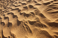 Rippled desert sand pattern in daylight. Closeup of abstract rippled desert sand in daylight Royalty Free Stock Photography