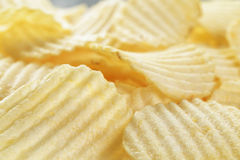 Rippled organic potato chips with salt Stock Photos