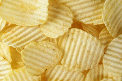 Rippled organic potato chips with salt Royalty Free Stock Photos