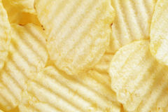 Rippled organic potato chips with salt Royalty Free Stock Photography