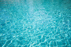 Rippled pattern of water in the swimming pool Stock Images