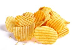 Rippled Potato chips. Pile of potato chips isolated on white background Stock Photos