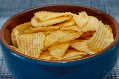 Rippled potato chips in a bowl Royalty Free Stock Photo