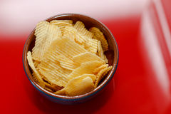 Rippled potato chips in a bowl Royalty Free Stock Image