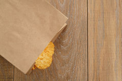 Rippled potato chips with paprika in paper bag Stock Image
