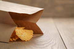Rippled potato chips with paprika in paper bag Stock Photo