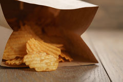 Rippled potato chips with paprika in paper bag Royalty Free Stock Photo