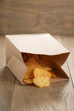 Rippled potato chips with paprika in paper bag Royalty Free Stock Images