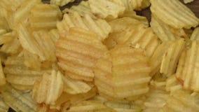 Rippled potato chips stock video