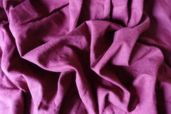 Rippled quiet colored plum linen fabric. Rippled quiet colored plain plum linen fabric Stock Images