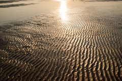 Rippled Red Brown Beach Sand Texture. Background Stock Photo