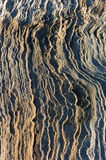 Rippled rock beside the sea background. Royalty Free Stock Photos