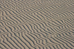 Rippled sand background. Sand background with ripples and texture Royalty Free Stock Images