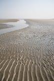 Rippled sand at the beach Stock Photo