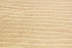Rippled sand on the sea coast formed by wind and water. Background, texture, pattern royalty free stock photography