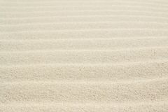 Rippled sand on the sea coast formed by wind and water. Background, texture, pattern royalty free stock photos