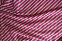 Rippled striped fabric in pink and white. From above Stock Images