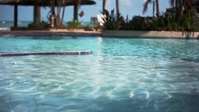 Rippled swimming pool water on sea view background in sunny day. 1920x1080