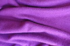 Rippled thin fuchsia colored knitted fabric Royalty Free Stock Images