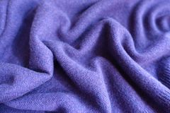 Rippled violet thin simple woolen jersey fabric. Rippled violet thin simple woollen jersey fabric Stock Images