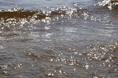 Rippled water and sand on the edge of on the southern shore of Lake Superior. Background texture with space for text. Stock Photo