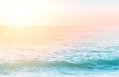 Rippled water surface with morning light. And blured horizon line Stock Photos