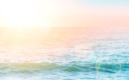 Rippled water surface with morning light. And lensflare effect Royalty Free Stock Photo