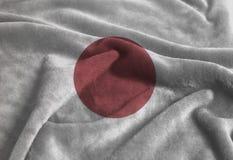 Waving Japan flag. Rippled Waving Japan flag background close up stock photography