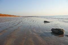 Rippled wet beach at low Tide stock photography