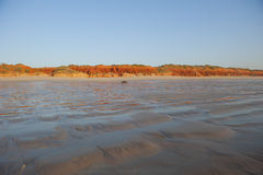 Rippled wet beach at low Tide stock photos