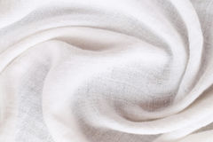 Rippled white calico of surface fabric. Rippled white calico of surface fabric for the design background Royalty Free Stock Photography