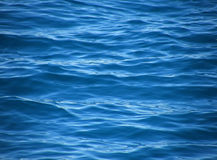 Ripples on blue sea. Reflection and blur waves on beautiful clear blue Adriatic sea (Croatia-Dalmatia). Horizontal color photo Royalty Free Stock Image
