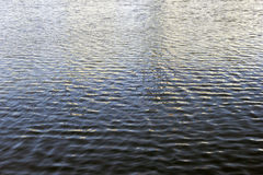 Ripples on the blue water of Moscow river close up Stock Image