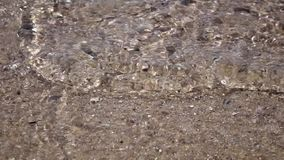 Ripples of clear sea water reflections over sands at he bottom. Close up. Slow motion. Ripples of clear sea water reflections over sands at he bottom, sandy stock video footage