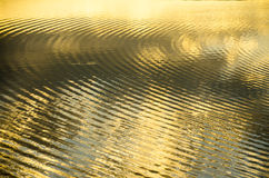 Ripples. Golden ripples on water surface Royalty Free Stock Image