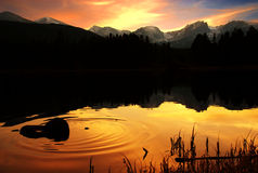 Ripples of peace. A calm lake in the rockies of Colorado at sunset stock photography