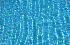 Ripples on pool water surface Royalty Free Stock Photo