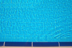 Ripples and reflections in water of summer swimming pool Stock Image